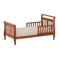 Storkcraft - Soom Soom Toddler Bed in Cognac Finish - Give your child a cozy and comforting place to sleep with this stylish toddler bed. Fits your standard crib mattress and comes with side rails so your little one feels safe and secure, making the transition from crib to big kid bed easier. The wood construction is long lasting and sturdy while the cognac finish is made to accent any decor.