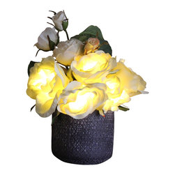 The Firefly Garden - Radiant Roses, White and Yellow, Purple Ceramic Vase - Bring the delights of Spring and Summer to your home with a choice of illuminated Rose colors housed in a selection of vases to fit any style. Accented with other bright florals, this 9 inch glowing arrangement is perfect for a guest bedroom or a subtle bathroom light in the evening. Uses three replaceable AA batteries.