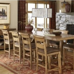 Legacy Logan 9 Piece Counter Height Dining Table Set - Large dining rooms call for bold and dramatic furniture styles, and you'll find no contemporary rustic set more outsized in its appeal than the Legacy Logan 9 Piece Counter Height Dining Table Set. This classic collection includes a farmhouse-style table with trestle base and plank top, and eight chairs with a rolled ladderback design that shows off the natural beauty of oak solids and veneers in a worn khaki finish.About Legacy Classic FurnitureCommitted to offering the best of today's youth-bedroom styles for the young and young at heart, Legacy Classic Furniture offers a wide selection of best selling designs and finishes with a large variety of beds and storage and study options. Dedicated to providing outstanding quality at reasonable prices, Legacy Classic Furniture employs quality materials, proven construction techniques, and the highest safety standards to manufacture exceptional products that are built to last a lifetime.Note about drawer features:All Legacy products use Kenlin's Rite-Trak drawer guide system. Exceptionally quiet and smooth, this system features positive stops and close tolerances for better drawer fit. Kenlin drawer guides are made with precision steel guides and runners, permanent lubrication, and specially engineered plastic components for years of reliable performance.