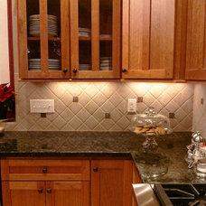 Traditional Tile by CC&J Designs. LLC