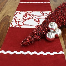 Chooty and Co Passion Suede Cinnabar Joliet Scarlet Table Runner - Modern and festive, the Chooty and Co Passion Suede Cinnabar Joliet Scarlet Table Runner is a handsome addition to your holiday table or buffet. This table runner is crafted of 100% polyester suede in a festive red. It features a panel of winter white with oversized red floral design and is accented by white ric rac trim. Hand- or spot-clean for lasting beauty.About Chooty & Co.A lifelong dream of running a textile manufacturing business came to life in 2009 for Connie Garrett of Chooty & Co. This achievement was kicked off in September of '09 with the purchase of Blanket Barons, well known for their imported soft as mink baby blankets and equally alluring adult coverlets. Chooty's busy manufacturing facility, located in Council Bluffs, Iowa, utilizes a talented team to offer the blankets in many new fashion-forward patterns and solids. They've also added hundreds of Made in the USA textile products, including accent pillows, table linens, shower curtains, duvet sets, window curtains, and pet beds. Chooty & Co. operates on one simple principle: What is best for our customer is also best for our company.