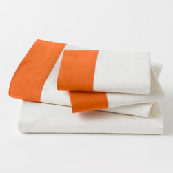 DwellStudio Modern Border Tangerine Sheet Set - For a tiny touch of this great fall shade, the stripe of this sheet is ideal. We love an unexpected shade peeking out from behind a white sham.