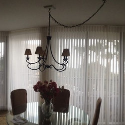 Window Treatments for Sliding Doors - Luminette Window treatments from Hunter Douglas.  Beautiful sheer drapes with the function of a vertical blind add beauty to these sliding doors.