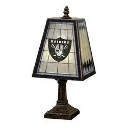 The Memory Company - Novelty Lamps: NFL 14 in. Oakland Raiders Art Glass Table Lamp NFL ORA 462 - Shop for Lighting & Fans at The Home Depot. Here s a beautiful addition to our popular lighting collection, this 14-inch table lamp with its hand-painted glass shade sporting team colors and logo! Classic in design, this elegant lamp sits on a brass-based resin stand and will be a lovely accent to any decor, in any room. Made by The Memory Company, this Art-Glass Table Lamp is inspired by the classic Mission style art-glass of the 20th Century.