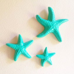 Aqua Starfish Wall Art - Set of 3 - Take yourself to the seaside each time you enter the room. This little starfish trio is the perfect small touch to give a room that beachy feel. In a bright, sea glass-like shade, they're a sweet accent to photos and other memorabilia.