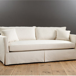 Ballard Designs - Bradley Bench Seat Sofa - Expertly upholstered in the USA. Available in over 200 fabrics or send us your own. Throw pillows sold separately. Fiber-wrapped down-blend cushions. Artisan crafted hardwood frame. Not too traditional, not too contemporary, our Bradley Sofa has the timeless lines of a modern classic. Sleek shelter arms are gently splayed, creating a welcoming embrace of deep seat comfort. The sleek Bench seat is great for seating a crowd. Bradley Sofa features:. . . . .