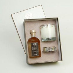 Frontgate - Antica Farmacista Manhattan Diffuser & Candle Set - Contains an 8 oz. diffuser, a 9 oz. round candle and a luxuriously detailed nickel-plated tray. Manhattan features top notes of zesty Satsuma and bergamot balanced with notes of vetiver, amber, brandied cherry, and cognac. Diffuser arrives in an antique-inspired apothecary bottle. Insert the white birch reeds through the open neck to diffuse the scent; invert the reeds every few days or as desired to enhance the effect. Candle is produced in a clear glass vessel with a platinum leaf pattern. The Antica Farmacista Manhattan Diffuser and Candle Set is a beautiful collection for adding fragrance to your home. The diffuser imparts a long-lasting fragrance, making any room smell fresh and clean. The candle delivers 60 hours of scented illumination.  .  .  .  .  . Made in USA.