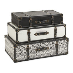 IMAX - IMAX Aberdeen Storage Trunks - Set of 3 - 47560-3 - Shop for Trunks and Chests (not dressers) from Hayneedle.com! The IMAX Aberdeen Storage Trunks - Set of 3 is a fantastic solution to a cluttered closet or a room in desperate need of redecorating. This three-piece set includes a small black trunk medium-sized white trunk and large grey and white piece. All three offer a vintage appeal and quality construction comprised of durable MDF and handsome leather and iron accents.Additional InformationSmall Dimensions: 5.5L x 11.5W x 23H in.Medium Dimensions: 6.5L x 13.5W x 25H in.Large Dimensions: 8L x 15.75W x 28H in.About IMAXWhat began as a small company importing copper flower containers in 1984 by Al and Faye Bulak has developed into one of the top U.S. import companies serving the At Home market today. IMAX now provides home and garden accessories imported from twelve countries around the world housed in a 500 000 square foot distribution center. Additional sourcing product development and showroom facilities in the USA India and China make IMAX a true global source. They're dedicated to providing products designed to meet your needs. This is achieved through a design and product development team that pushes creativity taste and fashion trends - layering styles periods textures and regions of the world - to create a visually delightful and meaningful environment. At IMAX they believe style integrity and great design can make living easier.
