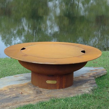 """Fire Pits - Great for Fall and Winter - The Saturn Wood Burning Fire Pit will change the atmosphere of your outdoor living space. Have you ever felt constrained by the small and frail fire pits found throughout the market? If so, then this fire pit could be the one for you. Constructed from 1/4"""" thick steel assures you of having this functional art for many years to come. The iron oxide patina will darken a little with time then become permanent. The inside is coated with a high temperature resistant paint and has a rain drain in the bottom. The Saturn Wood Burning Fire Pit is approximately 3 feet wide at the top and can accommodate impressively large fires if desired."""