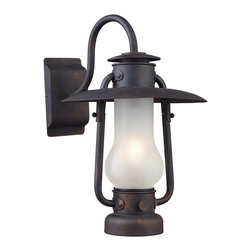 Elk Lighting - Chapman 1-Light Sconce in Matte Black - This series is reminiscent of the hurricane oil lanterns predominantly used in railroad and nautical applications in the late 1800's. Although powered by electric, the essence of this old world inspired collection remains. The matte black finish of the heavy ironwork cleverly contrasts the acid etched blown glass to complete the historic appeal.
