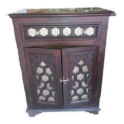 Kenza - Consigned - Moroccan Wood Cabinet - Moroccan wood cabinet, completely hand carved with traditional moorish design. The metalwork is made of nickel. This piece as a drawer, two doors with a silver latch and one wooden shelf inside. From the 80's.