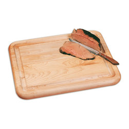None - The Carver Jumbo Chopping Block w/ Feet - Make food preparation easier by adding a jumbo wood chopping block to your kitchen counter. This cutting board is made of one-inch-thick hardwood,so the block can stand up to heavy use over time. Rubber feet ensure the block stays in place when used.