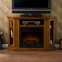 Holly & Martin™ Ponoma Convertible Media Electric Fireplace-Mahogany - Holly & Martin™ Ponoma Convertible Media Electric Fireplace-Mahogany has a triangular media storage shelves on either side of the firebox provide plenty of space for your favorite media selections and are enclosed by glass doors. It has additional media equipment shelf rests above the firebox and is complete with convenient back wall cord access. This fireplace mantel is also designed with a collapsible panel, allowing for versatile placement against a flat wall or corner in your home.