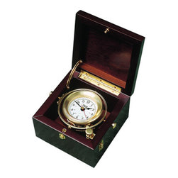 "Weems & Plath Gimbal Box Clock - A sturdy wooden box was typically used to hold and protect the valuable ship's clock. Early versions of these old clocks can be seen at Maritime Museums such as Mystic Seaport in Connecticut. Today we offer these authentic ""box clocks"" with a more reliable and accurate quartz movement. This modern quartz clock is made with high quality movement and then mounted in a beautiful solid wood mahogany finish box. It rests in a traditional polished brass ship's chronometer gimbal with locking arm. The 5.75"" square box has polished brass fittings and is provided with a brass plate for personalization. The elegant instrument will be displayed with pride for years to come. The dial is 2.38"", the box is 5.75"" x 5.75"" x 3.75"" and it weighs 3lbs 3oz. It comes with complete instructions, a fresh battery and a lifetime warranty."