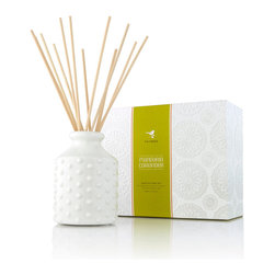 Mandarin Coriander Hobnail Diffuser - A chic hobnail bottle crafted in white ceramics tips a hat to a vintage motif while scenting your home with the juicy, slightly sharp citron aroma of the Mandarin Coriander designer fragrance. A subtle undertone of sweetness lends sophistication to the fragrance oil, which is absorbed by the home fragrance diffuser's rattan reeds to bring the awakening, refreshing orange into your surroundings.