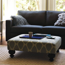 Printed Essex Ottoman - An Old World charmer. With its decoratively turned legs and eye-catching prints, this versatile Essex Upholstered Ottoman works equally well as a coffee table, footrest or in-a-pinch seating.