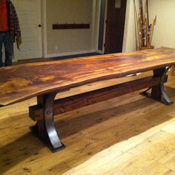 Live Edge Furniture - Claro Walnut Slab with reclaimed barn beam trestle and wrought iron accents.