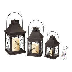 """Asian Import + USA - Captain's Lantern Collection Set with Flameless Color Candles - Captains used ones like it to read navigation""""maps when there were no incandescent lights on board. This candle lantern trio from the Classic Collection has the perfect blend of traditional design and contemporary styling. Four clear glass panels sit behind iron crossbar grillwork and finished in matte bronze. They stand 12"""" 15""""and 20"""" High. Included are 4"""", 5"""" and 6"""" Avion Select melted edge color wax candles with a remote control timer. Note that candles pictured are for presentation only. The candles included in the set are described above."""