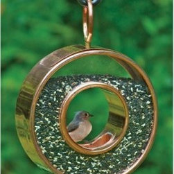 Good Directions Polished Copper Fly-Thru Bird Feeder - The charming design of the Good Directions Polished Copper Fly-Thru Bird Feeder is a perfect fit for every garden, yard, and home. This round feeder features a transparent ring for bird food, one perch, one feeding hole, and copper construction.About Good DirectionsGood Directions got its start by creating weathervanes and cupolas, but it has expanded its line to include a wide range of decorative yet functional products for the home and garden, including popular Fire Domes, rain chains, and garden weathervanes. The company continues to attract innovative artists and designers eager to lend their vision to the creation of exceptional products to enhance the home, both indoors and out. No matter which way the wind blows, you can count on Good Directions to show you the way to a beautiful home.