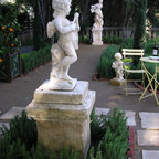 Loire Valley Garden Art by Charme d' Anan - Period pieces enhanced the experience, raising the eye from the garden's delights.