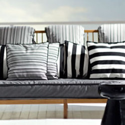 Inout Sofa - This sofa has a great cottage feel to it but still compliments more contemporary furniture. With the mass of pillows you can sink back into it or change them out for a different look.