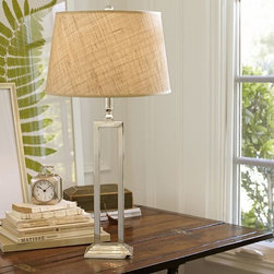 Calvin Bedside Lamp - Lighting can be very person-specific, but if you know the recipient well, a table lamp can be a wonderful gift — especially for first-time homeowners. Stick with something neutral, like this one with a metal base.