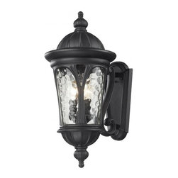 Three Light Black Water Glass Wall Lantern - Traditional and timeless, this medium outdoor wall mount combines black cast aluminum hardware with clear water glass for a classic look.