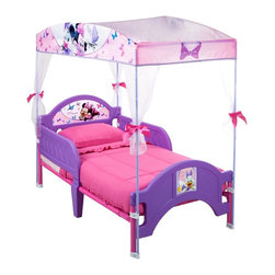 Delta - Delta Minnie Mouse Canopy Bed - Make her space extra special with a little help from Minnie Mouse from Delta Children. This Minnie Mouse canopy toddler bed helps the transition from crib to toddler bed easy with a low to the ground design and elegant tulle sheers gathered with ribbons.
