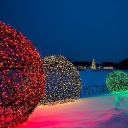 LED Light Balls - Commercial Outdoor Christmas Decorations - Commercial outdoor Christmas decorating ideas include wrapping LED light balls at the Chicago Botanical Gardesn in Illinois. LED light balls, which consist of mini LED lights, are perfect for decorating a empty outdoor spaces during Christmas, the holidays, weddings and more.