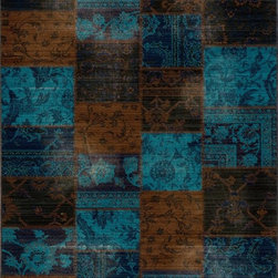 "Momeni - Momeni Vintage VIN13 (Indigo) 9'10"" x 12'6"" Rug - Meant to emulate the over-dyed and patchwork handknotted rugs that are so popular today, Vintage interprets this look in a power-loomed quality with hand-sheared finishing that gives each design the look of a distressed, antiqued piece. Made of 100% NZ Wool. Due to the hand sheering of this product and in order to enhance the beauty of this collection each piece may vary slightly."