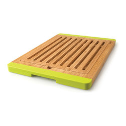 "Berghoff - Berghoff Bamboo bread board open groove - Chopping board features lime green silicone accents to prevent skidding and open groove design to allow crumbs to fall through. Bamboo chopping boards are seeing a resurgence in popularity as they are considered a green product."" Caring for bamboo cutting boards is easy, just wash with soap and water. The natural beauty and durability is unique."
