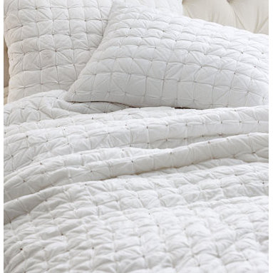 Eileen Fisher Box-stitch Cotton Quilt and Sham - I'm pretty basic when it comes to bedding; I think that less is more. I almost always go with a solid quilt, and the box stitch on this one is my favorite. It's pretty and simple and easy to launder. Pair this with a decorative duvet at the foot of the bed and some pretty shams or pillows, and you're set.