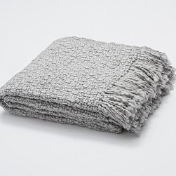 "Metallic Knit Fringed Throw, 50 x 60, Smoke Gray - An instant, dazzling way to dress up a sofa or bed, our throw has a little metallic thread interlaced into its chunky weave. 50 x 60"" Made from an acrylic/polyester blend. Hand-knotted fringe ends. Yarn dyed for vibrant, lasting color. Dry-clean. Imported."