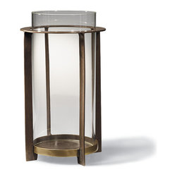 "Frontgate - Sydney Hurricane - Large - Frame is constructed of 100% brass with a glass hurricane insert. Finished with a cold patina chemical dip. Glass hurricane insert measures 7"" dia.. Medium holds a 4"" x 6"" candle; Large holds a 4"" x 9"" candle. Candle sits directly on brass frame. The contemporary design and beautiful brass frame make our Sydney Hurricane a welcome presence in an entryway or atop a side table. Sleek and sophisticated, the sturdy, modern piece holds a glass shade that shelters the flame and amplifies the glow. A beautiful way to show off a flickering candlelight, this all-weather hurricane provides beautiful illumination year-round.  .  .  .  .  . A Frontgate exclusive . Imported."