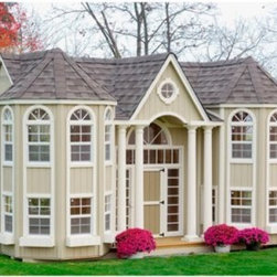 Little Cottage 10 x 16 Grand Portico Mansion Wood Playhouse - The Little Cottage 10x16 Grand Portico Wood Mansion Playhouse offers incredible detailing and design. Let your child experience the ultimate in playhouses with this luxuriant mansion, which is loaded with authentic details like real working windows, a loft with ladder, transom windows, and more. Sure to be the talk of the neighborhood, this extraordinary playhouse is durably designed for years of enjoyment, and arrives at your door in a ready-to-assemble kit. It is designed for an advanced DIY person and is estimated to take two people two days to construct. This playhouse includes: 2 x 3 wood wall framing 2 x 3 wood trusses Siding and trim pre-fastened to wall panels Panelized pre-cut wall panels for easy assembly Pre-primed siding and trim ready to paint 22 working windows with Plexiglass, grids, and screens (14 x 21 inches each) 10 flower boxes Loft with ladder 4 stately porch columns Child door in front (20W x 40H inches) Adult French door in back Transom windows to frame front door High-quality composite exterior corner trim Loft with ladder on turret side All required hardware Link to downloadable full-color instruction manual In order to complete assembly, you will need to supply the following: Roof shingles (approximately 9 bundles) Dripedge (roof edging) (approximately (9) 10-foot pieces),/li> Paint (in the colors of your choice!) 2 pressure-treated 4 x 4 x 16-foot pieces of wood 3 pressure-treated 4 x 4 x 13-foot pieces of wood This playhouse is constructed using LP Smart Side, an environmentally sound wood that's known for durability. LP Smart Side offers low pollution production, and is highly renewable. It's also treated with care using a SmartGuard finish, which uses zinc borates to resist rot and mold while minimizing chemical use and pollutant output. Because LP Smart Side is so strong and safe, the playhouse pieces are covered by a 50-year limited warranty from LP. About The Little Cottage CompanyNestled in the heart of Ohio's Amish country, The Little Cottage Company resides in a quaint, slow-paced setting where old-fashioned craftsmanship and attention to detail have never gone out of style. Our experienced carpenters and skilled designers take great pride in creating top-quality, pre-built models and Do-It-Yourself kits of playhouses, storage sheds, and more.