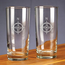 Frontgate - Set of Four Nautical Iced Tea Glasses - Handblown with lead-free crystal. Heavyweight bottoms add heft and durability. Makes an ideal gift for any occasion. Top-rack dishwasher safe. Bring the spirit of the seas to sparkling, handcrafted crystal with our Nautical Design Glassware. Each set of four glasses includes deep etching of each of the following designs: a seahorse, compass rose, anchor, and palm tree. Choose from three traditional bar glass sets, each of which bespeaks sophistication.  .  .  .  . Made in the USA.