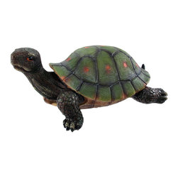 All Who Wander Turtle - This incredibly lifelike cold cast resin gopher tortoise garden statue is the perfect addition to gardens, patios and lawns. The tortoise measures 5 1/4 inches tall, 11 1/2 inches long and 7 3/4 inches wide. The detail is incredible, from the hand painted eyes to the markings on his shell.