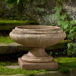 Campania International Marella Cast Stone Urn Planter - About Campania InternationalEstablished in 1984, Campania International's reputation has been built on quality original products and service. Originally selling terra cotta planters, Campania soon began to research and develop the design and manufacture of cast stone garden planters and ornaments. Campania is also an importer and wholesaler of garden products, including polyethylene, terra cotta, glazed pottery, cast iron, and fiberglass planters as well as classic garden structures, fountains, and cast resin statuary.Campania Cast Stone: The ProcessThe creation of Campania's cast stone pieces begins and ends by hand. From the creation of an original design, making of a mold, pouring the cast stone, application of the patina to the final packing of an order, the process is both technical and artistic. As many as 30 pairs of hands are involved in the creation of each Campania piece in a labor intensive 15 step process.The process begins either with the creation of an original copyrighted design by Campania's artisans or an antique original. Antique originals will often require some restoration work, which is also done in-house by expert craftsmen. Campania's mold making department will then begin a multi-step process to create a production mold which will properly replicate the detail and texture of the original piece. Depending on its size and complexity, a mold can take as long as three months to complete. Campania creates in excess of 700 molds per year.After a mold is completed, it is moved to the production area where a team individually hand pours the liquid cast stone mixture into the mold and employs special techniques to remove air bubbles. Campania carefully monitors the PSI of every piece. PSI (pounds per square inch) measures the strength of every piece to ensure durability. The PSI of Campania pieces is currently engineered at approximately 7500 for optimum strength. Each piece is air-dried and then