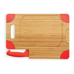 Picnic Time - Picnic Time Culina Cutting Board - Natural Wood with Red Accents - 917-00-100-00 - Shop for Cutting Boards from Hayneedle.com! When it's time to cut down a tenderloin carve a turkey or just slice up some meats and cheeses to chomp on while you enjoy your pinot noir the Picnic Time Culina Cutting Board - Natural Wood with Red Accents is everything you need to get started. The body is crafted from sustainably grown bamboo with a food-safe finish that highlights the tight natural grain of bamboo. A recessed juice groove keeps the fluids on the board and a simple pivoting lift makes it perfect for using next to a sink. On the edge of the board is an integrated slot that holds the included carving knife. Durable ceramics give this blade a sharp edge that you'll be using for years. About Picnic TimeEven the name makes you smile! Since 1982 Picnic Time's mission has been to sell traditional European-style picnic baskets in America that everyone could afford. The company has continued to develop innovative and practical outdoor leisure products that inspire relaxation with friends and family. With a product line that continues to develop far beyond the traditional picnic basket (though theirs are the finest picnic baskets around!) Picnic Time will take you to the beach the country the mountains ... or best of all your own backyard.