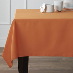 """Fete Pumpkin 60""""x90"""" Tablecloth - Soft cotton tablecloths spread gorgeous tones of saturated color that mix and match with any number of table linens. Handsomely finished with 1"""" hem and mitered corners."""