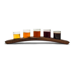 Bambeco Portland 5 Beer Flight - Clear - Our Portland 5 Beer Flight - Clear is made from reclaimed wine cooler bottles and wine barrel slats. Nestled in the arched holder, each glass holds up to seven ounces of your beverage of choice, ideal for a beer tasting. Or have some fun and pour wine, be sure to turn the tray to reveal its former life as a wine barrelExpand their useful lives even more and press these glasses into service as dip holders, nut or candy dishes, or even small dessert cups. The Portland Beer Flight Taster is available as a set of three or five glasses on a tray and comes in your choice of green or clear glass. Each tray is unique, and tray size, color and appearance will vary.Dimensions: 22W x 3D x 4.75H.The Portland 5 Beer Flight - Clear is currently out-of-stock but is scheduled to ship on or about June 1, 2014, and will be delivered carbonfree to your door.