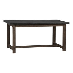 District Dining Table - A handsome wood base meets an iron top on this industrial modern dining table.
