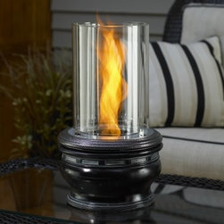 """Outdoor GreatRoom Apollo Tabletop Fire Pit - Give your patio table a centerpiece like none other with the Outdoor Greatroom Apollo Tabletop Fire Pit. This is a lightweight portable fire pit with a sleek black finish that compliments any exterior design. The durable resin and tempered glass were built to last and can withstand the elements. Venture flame technology creates a spinning flame effect through the glass cylinder that's sure to grab everyone's attention. Best of all the affordable gel fuel (sold separately) produces up to 9 000 BTUs of heat for over 3 hours. Sure to be a conversation piece the Apollo Tabletop Fire Pit is as comforting as it is awe inspiring. Measures 10 diameter x 17H inches with an overall weight of 14 lbs. About Outdoor GreatRoom CompanyWith over 50 patents to its name the Outdoor GreatRoom Company is one of the most innovative names in gas fireplaces and outdoor design period. Since 1975 Dan Ron Steve and Ger have produced a yard of amazing products like the Heat-N-Glo that have changed the industry. In fact they want to change the way you think about your backyard or patio. It's about bringing the luxury and comfort of the living room outside to make an """"""""Outdoor Room."""""""" They want you to literally think outside the box. To make that beautiful concept a reality Outdoor GreatRoom designs manufactures and sells pergolas outdoor kitchens grills outdoor furniture fireplaces fire pits lighting and heating products. There's no better name in outdoor leisure than this fine Minnesotan company."""