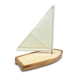"""Picnic Time - Sailboat Cutting Board - The Sailboat cutting board and tools set is a great gift for those who love boating. It's so beautiful, you'll want to display it amongst your most treasured home furnishings. Made of 100% bamboo, the Sailboat was designed with a drawer at the stern that opens to reveal three stainless steel accessories: two cheese tools and one waiter-style corkscrew. The tools are easy accessible when you need them, and hidden away when you don't. Includes: 1-17"""" x 7"""" Bamboo cutting board with a groove along perimeter to catch whey, brine or juice run-off; 1 Removable canvas sail with magnet to keep it anchored in the board; 2 full-tang stainless steel cheese tools with bamboo handles: 1 slant-tip cheese knife and 1 pointed-tip cheese knife; 1stainless steel, waiter-style corkscrew with bamboo handle"""