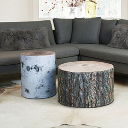 Krone Hanssen Wood Stubbe Poufs - These stumps may look like the real thing, but they are much more comfortable! Made from recycled materials and covered with photographic prints, these versatile poufs from Norwegian brand Krone Hanssen can be used as side tables or extra seating.
