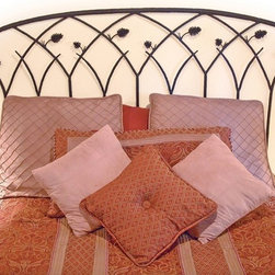Mathews & Company - Piney Woods Wrought Iron Headboard - This intricately handcrafted Piney Woods Wrought Iron Headboard brings rustic beauty to any bedroom. You can choose the complete look with headboard and footboard, or just a headboard and frame. Featuring carefully handcrafted iron pine cones and branches, the design of this wrought iron bed is inspired by the beauty of the forest. The Piney Woods bed comes in four finishes to perfectly match your personal style and home d��_cor: natural black, rust, aged pewter or aged bronze. Every bend and joint is painstakingly perfected for top quality, durability and beauty. Each piece is created individually by skilled artisan blacksmiths. Pictured in Black finish.
