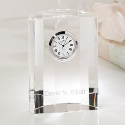 """Exposures - Personalized Crystal Desk Clock - Overview Commemorate a graduation, promotion, retirement or other milestone with this traditional symbol of success, an engraved crystal desk clock. Roman numerals add an elegant detail on the face, and facets on the rear catch light beautifully. The petite size makes this clock easy to display almost anywhere.    Features 100% lead-free crystal Analog quartz clock Silvertone trim Roman numerals Hour, minute and second hands Battery is included Half moon shape   Personalization  Can be engraved with up to 20 characters Upper and lower case No returns on personalized items unless the item is damaged or defective   Specifications  3 1/2"""" wide x 4 1/2"""" high x 1"""" deep   Shipping  Please allow 2 to 3 extra days for personalized items"""