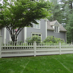 2012 Cedar Fence - Cedar Staggered Victorian picket fence accent, stained beige.