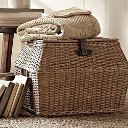 "Jacquelyne Rattan Angled Lidded Basket, Large - Our Jacquelyne basket is handcrafted from rattan with varied weaves rich in natural warmth and texture. It accommodates everything from craft supplies on a bookshelf to extra pillows by the hearth. 22.25"" wide x 17.75"" deep x 15.5"" high Made of handwoven rattan wicker. Iron hardware with a bronze finish. Latches are for decorative use, and do not secure basket."