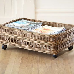 "Jacquelyne Rattan Under Bed Basket - There are more than 30 square feet of floor beneath a queen-sized bed. Our rolling basket lets you turn it into easy-access storage space. Both functional and charming, it's handcrafted with a distinctive banded pattern using two sizes of rattan. 25"" wide x 16"" deep x 9"" high Made of handwoven rattan wicker; plastic castors. Catalog / Internet only."